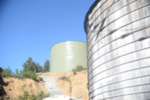 Shelter Cove old redwood water tank and new steel tank.