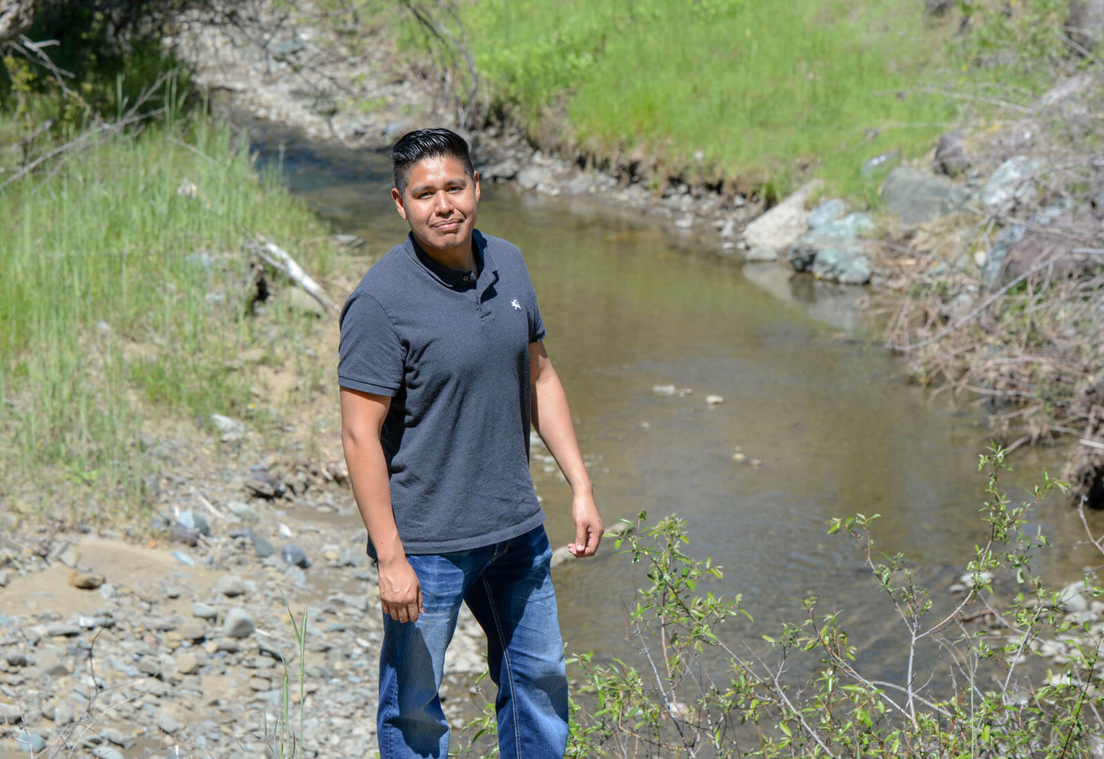 Geronimo Guevara stands in front of Angelica Creek.