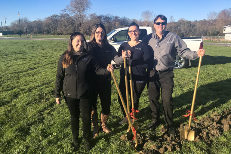 LACO employees with shovels at groundbreaking.