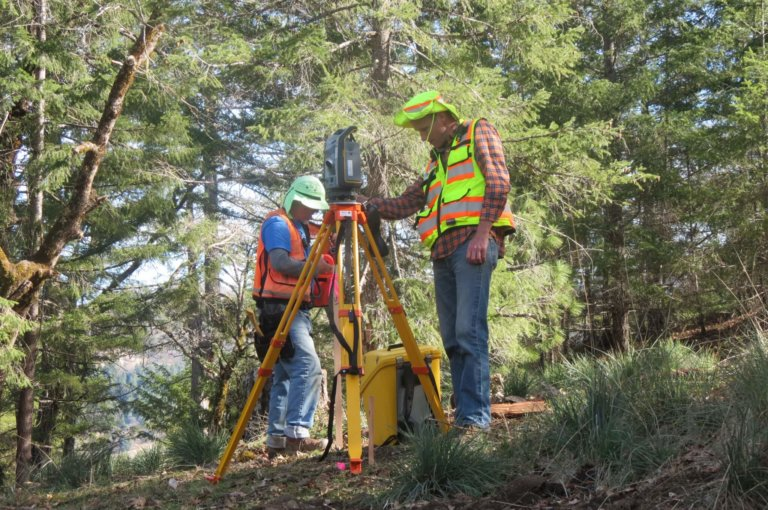Surveyors work in the field.